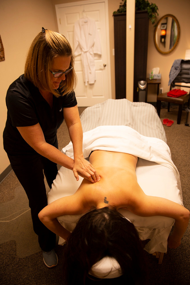 Woman massages client in a calm and comfortable room