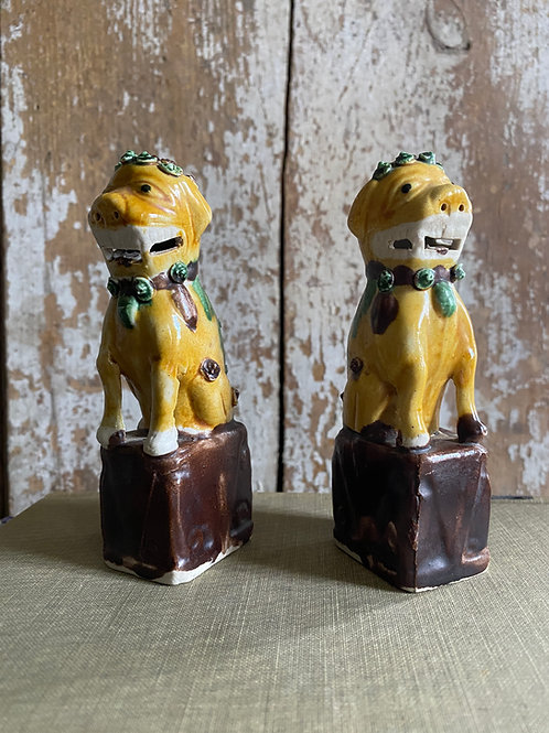 A SMALL PAIR OF OCHRE VINTAGE FOO DOGS