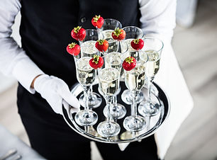 hospitality and champagne glasses with strawberry