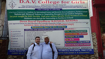 Dr Terry McIvor in front of DAV College, India