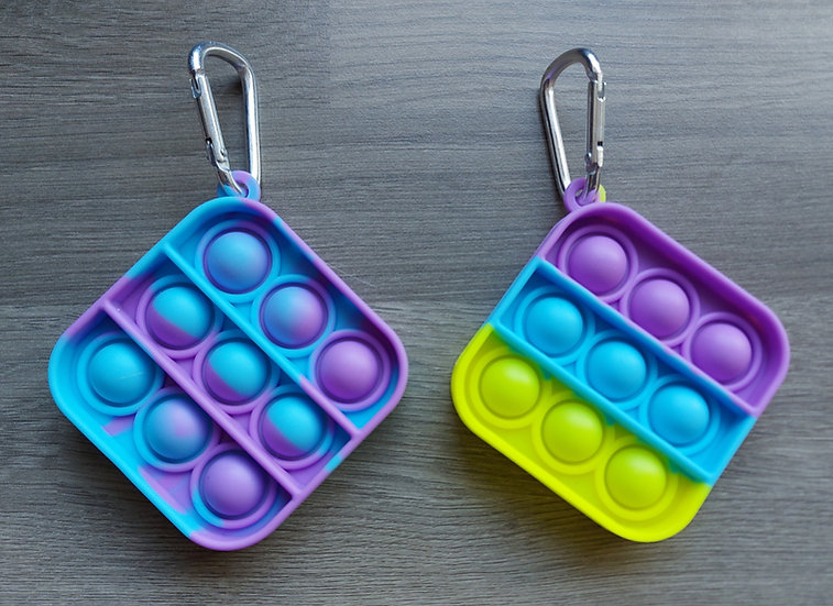 Small square fidget popper toy on carabiner clip