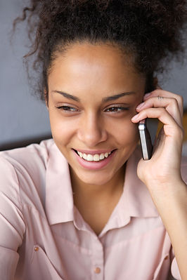 smiling-black-woman-talking-on-cell-phon