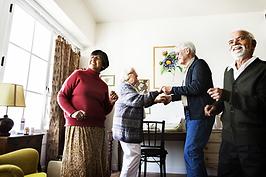 senior-friends-dancing-together-at-home-