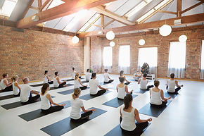 A photograph of a yoga class