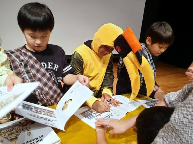 Young authors signing their books, Sticky but not Icky; The Lost Wonders of Kampong Gelam