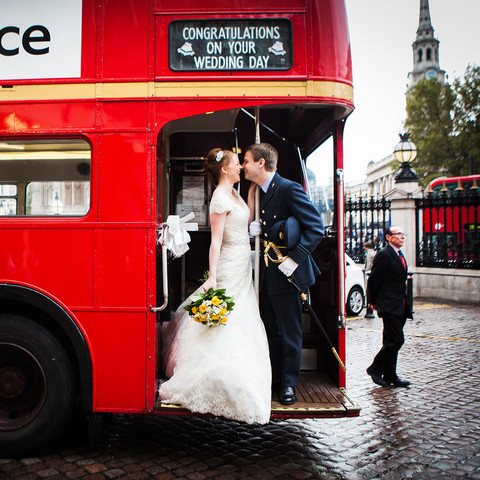 Bride and groom red bus