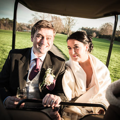 Bride and groom in golf buggy