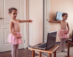 Pretty young ballerina practicing classi