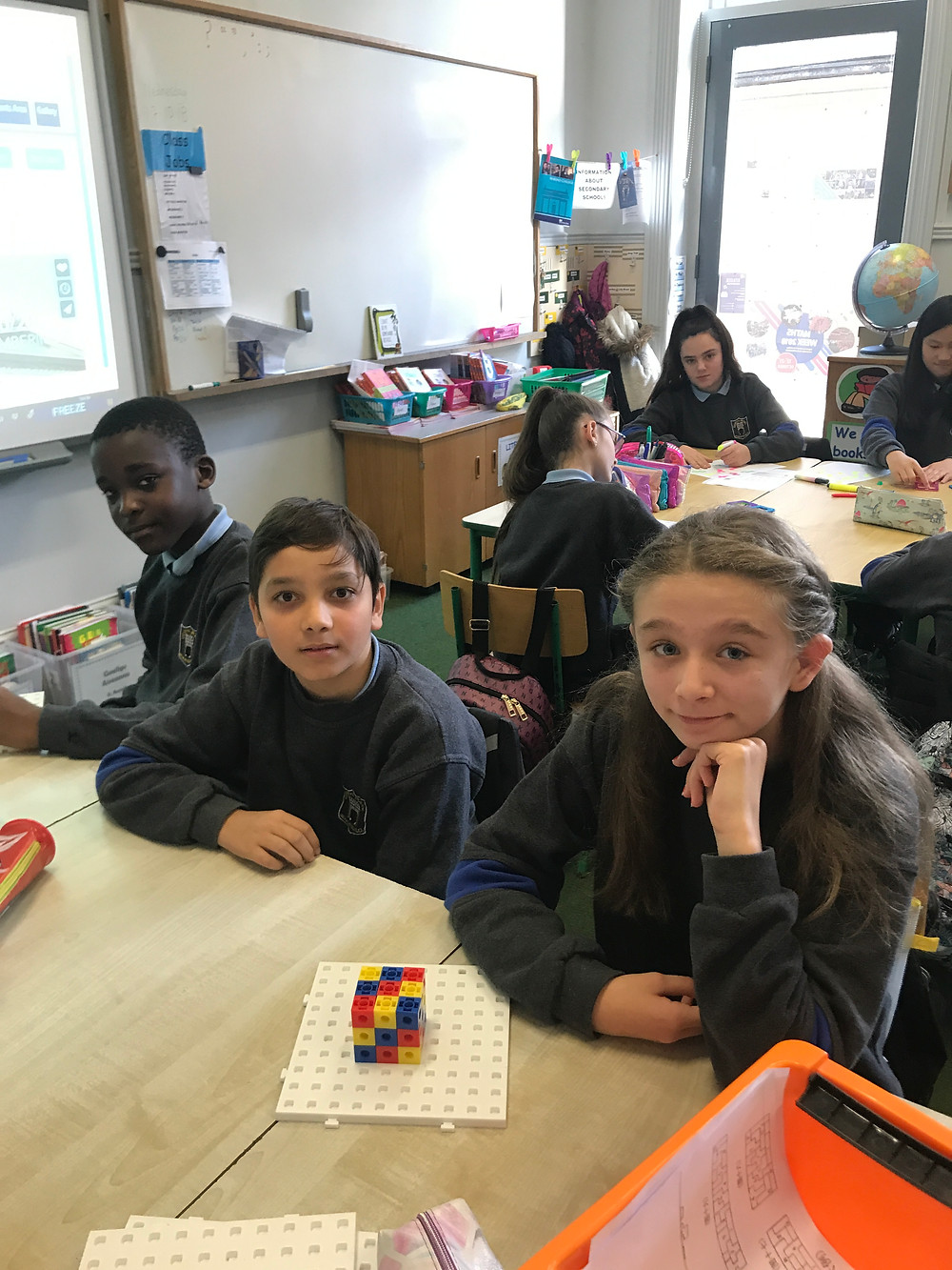 Children participating in some of the fun maths week activities taking place in the school.