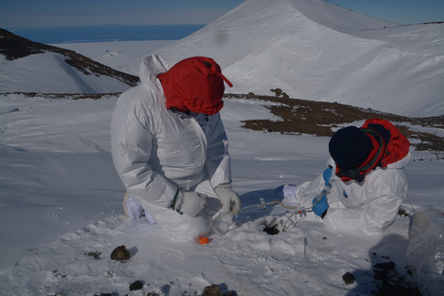 Direct sampling of gas from a fumarolic area.