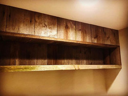 Reclaimed barn wood bookshelf we built today to cover a soffit in the reading nook