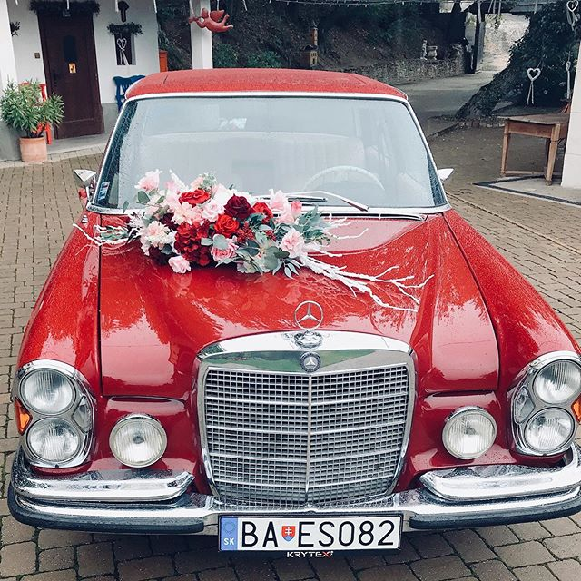 Wedding car decoration today in burgundy