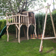 Reclaimed shed tree house and swings.jpg