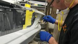 Applying fiberglass to Mustang