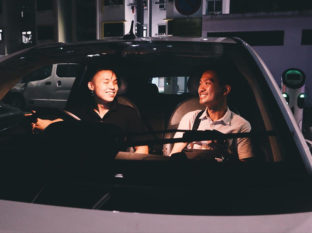 Friends in a BlueSG car