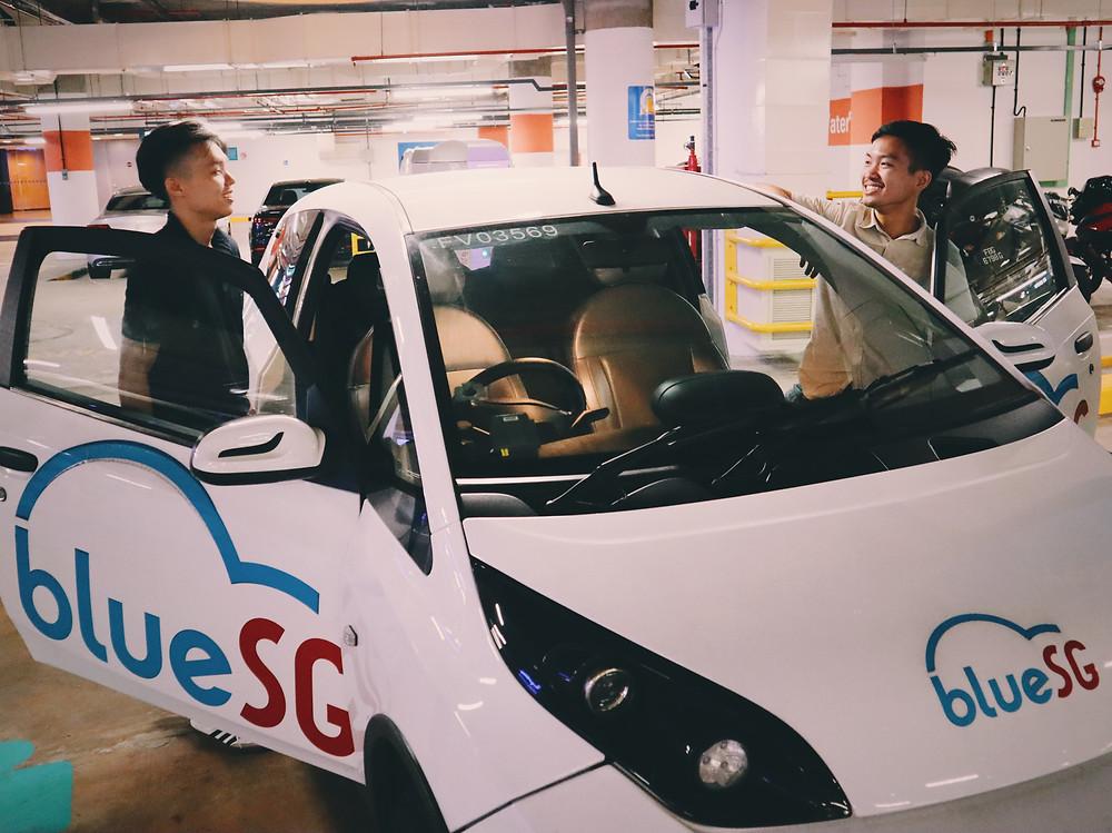 Friends getting into BlueSG car