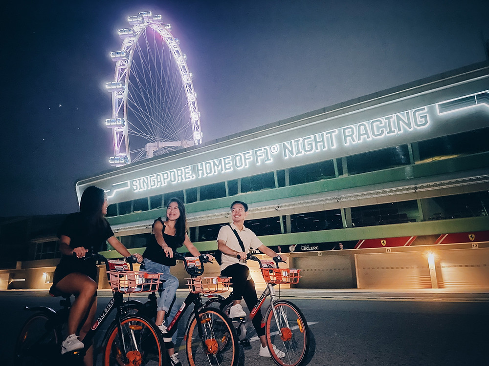 Friends cycling at F1 Pit Building