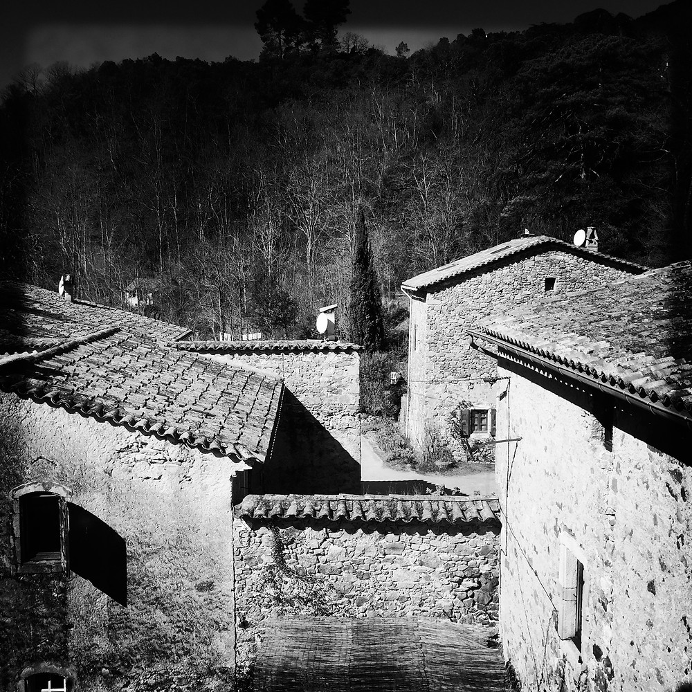 black and white photo of the beautiful roofs at Malérargues.