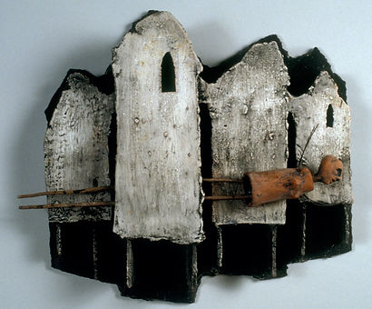 Human Figure and Houses in Clay