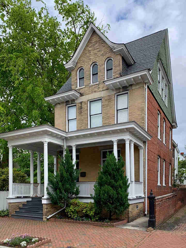 A three story home with a new roof