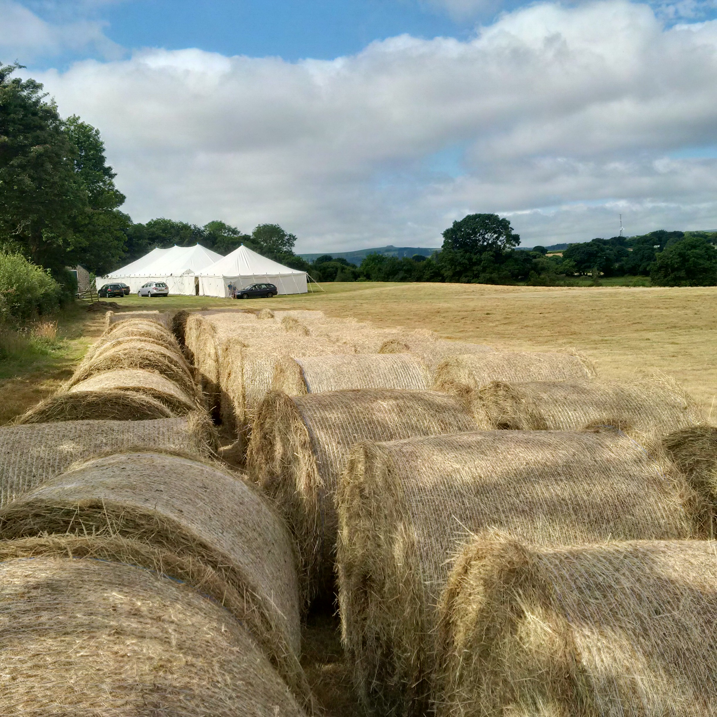 July at Monks Hay bales and Marquees