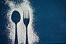 The outline of a spoon and fork in powdered sugar