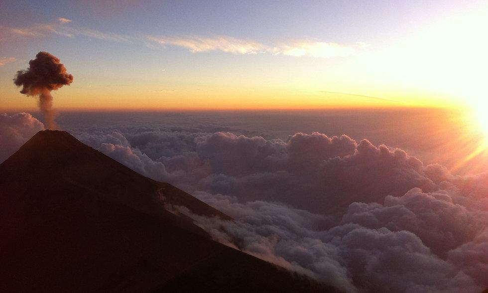smoke plume volcano sea of clouds sunset acatenango guatemala