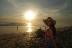 smiling girl on sandy beach
