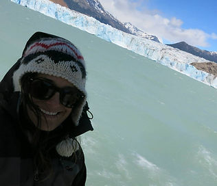 smiling girl in front of glaciers