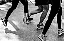 runners' shoes as they run