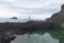 man standing on the edge of a tide pool on the West side, Maui, USA