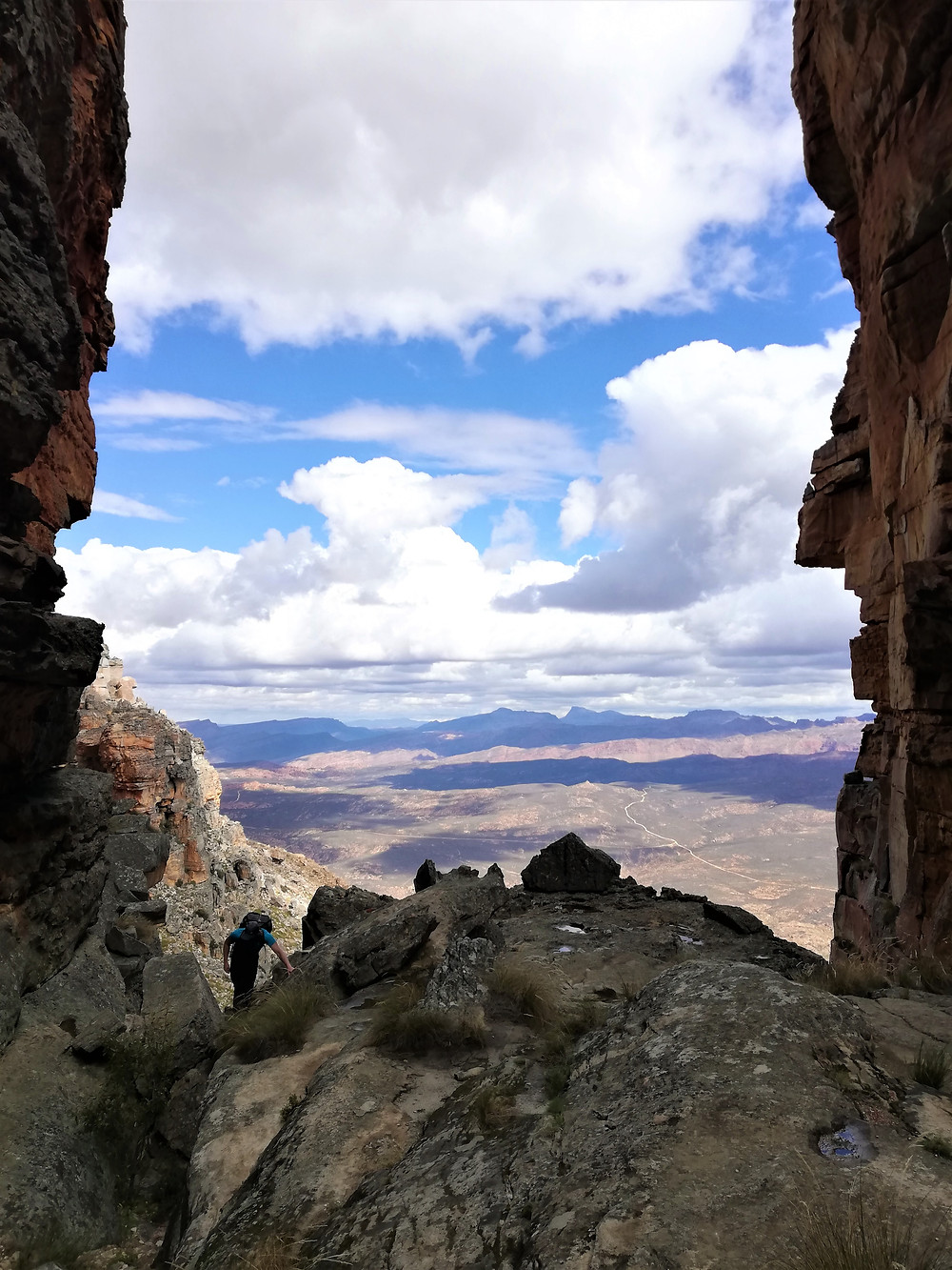 View looking out from between two rock faces