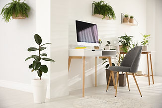 Modern workplace in room decorated with