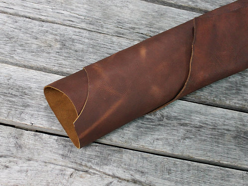 Worn Saddle Ochre Leather Rolled on Wood