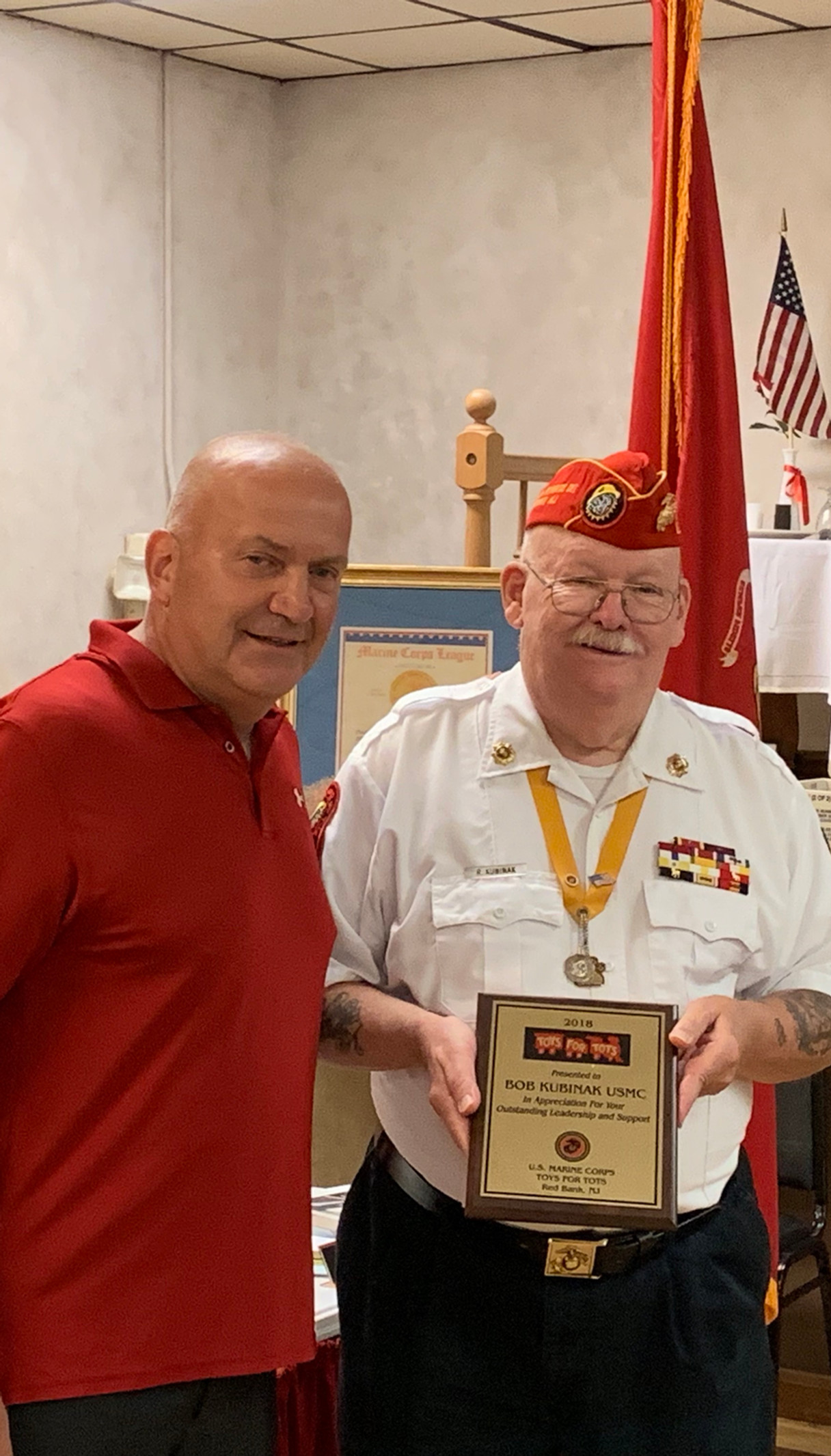 Toys For Tots Chairman Bob Kubinak recieves achievement award from Toys For Tots 2019