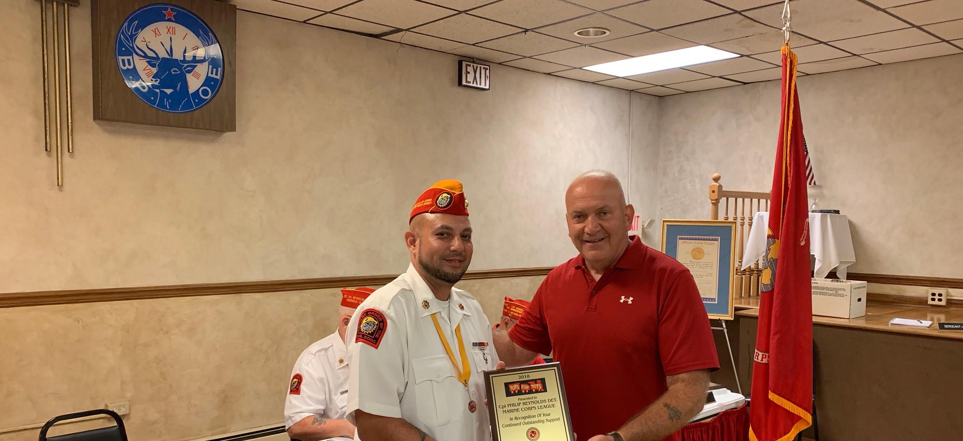 Commandant Zach Delacruz recieves Toys For Tots Award 2019