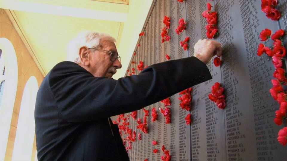 Veteran Keith Norrish placing poppy