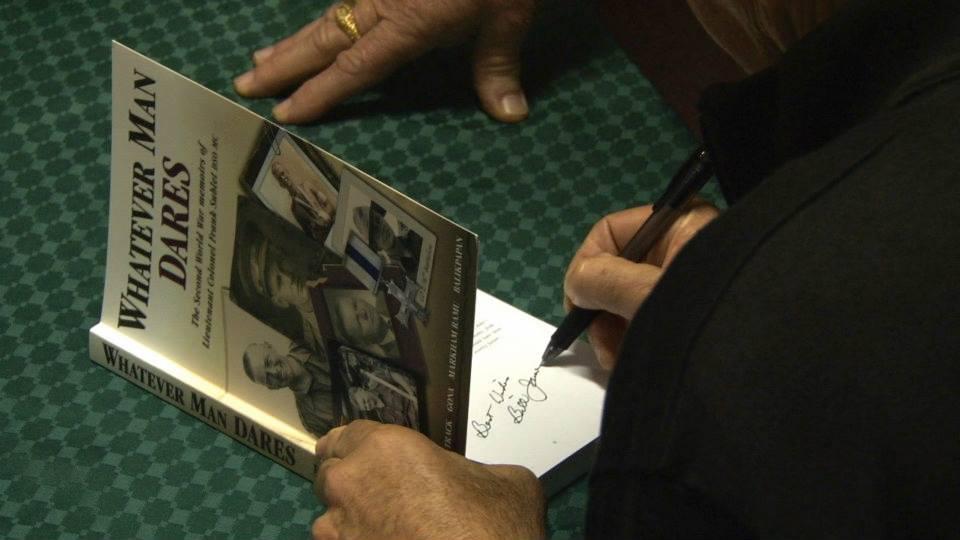 Bill James signing copies.