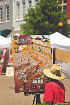 Maurice Cook painting a painting at TroyFest