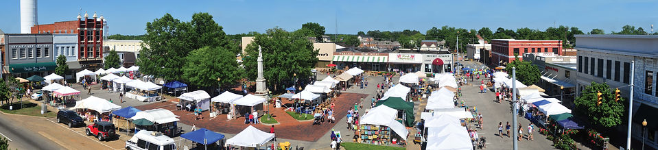 Downtown Troy, AL on beautiful TroyFest say. Many peopl shopping multiple vendors.