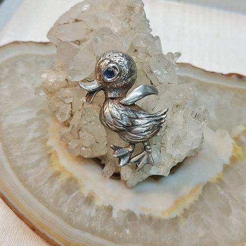 A silver ducky pin 500