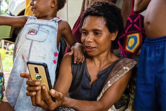 Female Farmer with AgUnity Phone PNG