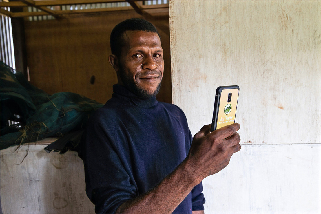 Male Farmer with Phone in Madang PNG