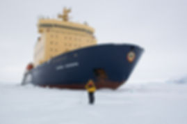 Wildlife photographer and artist S.K.Schafer with the  Kapitan Khlebnikov in the Antarctic Strait