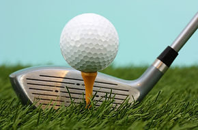 Image of a golf club and ball on a tee