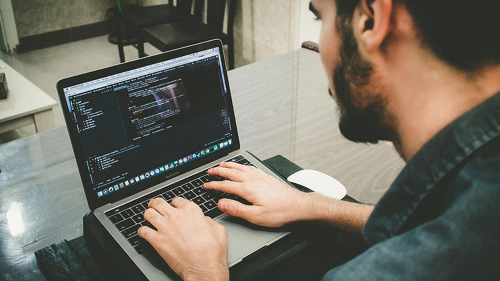 Programmer working on developing digital marketing
