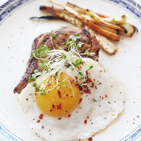 Pork Chop and Fried Duck Egg with Parsnip Fries