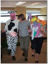 Cow singing telegram with balloo.jpg