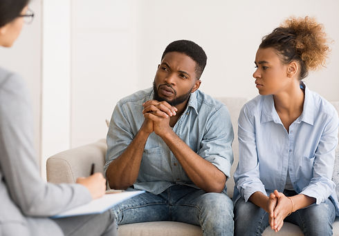 Marital%20Therapy.%20Black%20Couple%20Listening%20To%20Counselor's%20Advice%20Sitting%20On%20Couch%2