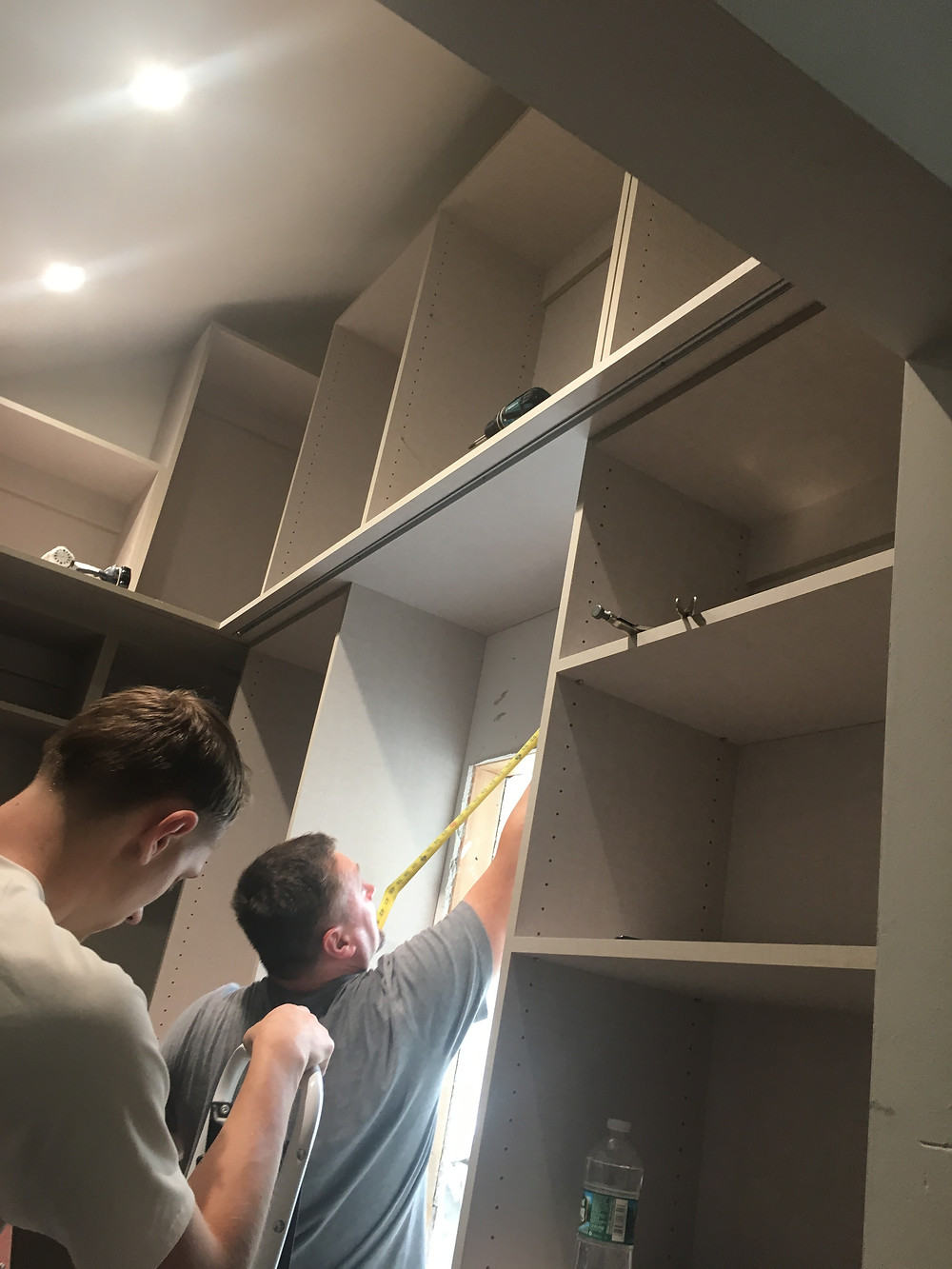Closet installers hard at work.